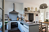 Silestone worktops in compact kitchen with basket lampshade