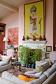 Oriental picture above fireplace in living room in shades of pink