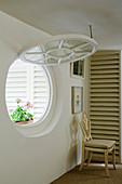 Open round window in period villa