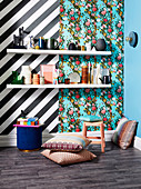 White shelves with decorative objects in front of black and white striped wallpaper and in front of floral wallpaper