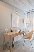 Modern console table against light grey wall