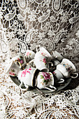 Vintage cups with floral motifs on plate