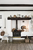Old wood-fired kitchen cooker in rustic country-house kitchen