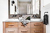 Narrow bathroom with double sink and large mirror