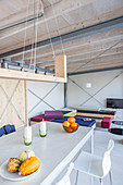 Modern houseboat: dining area and custom sofas in open-plan interior