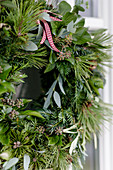 Wreath of pine, ivy, eucalyptus and yew on door