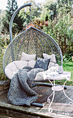Hanging chair in autumnal garden
