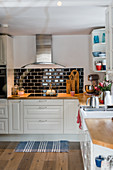 Black subway tiles in country-house kitchen