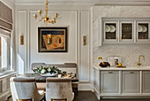 Luxurious kitchen-dining room in shades of grey