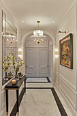 Luxurious hallway with marble floor and panelled walls