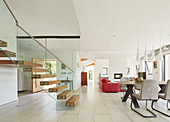 Floating stairs in modern, open-plan interior