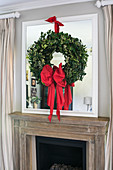 Ivy wreath tied with red ribbon