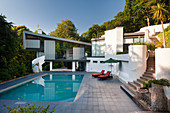 60s-style, architect-designed house with cantilever extension, monopitch roof and pool