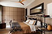 Fitted wardrobes in English-style bedroom in shades of brown