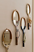 Mirrors with frames made from old tennis rackets and hook on wall