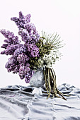 Bouquet of lilac with fruits of the trumpet tree