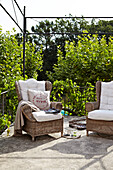 Wicker armchairs on country house terrace