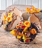 Arrangement of roses, Cymbidium orchids and elderberries