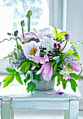 Bouquet of magnolia, peonies, lilac and alliums