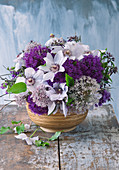 Bouquet of clematis and alliums