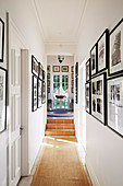 Aisle escape in beach house with a view of picture walls and model ship