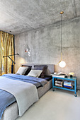Urban-style bedroom in shades of grey with concrete wall