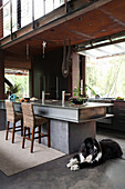 Open kitchen in industrial style with kitchen island made of steel beams