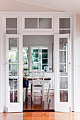 View through open double doors into the dining room of a renovated Queenslander