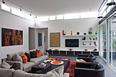 Lounge in the living room in designer style with window strips