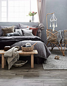 Cozy bedroom in dark earth tones with a baby bed