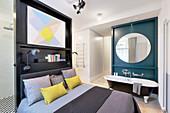 Adjacent bedroom and bathroom areas in open-plan interior