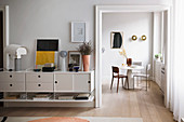 Floating sideboard next to open doorway with view of dining table