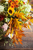 Lavish autumn bouquet of hydrangeas, chrysanthemums, sunflowers and oak leaves
