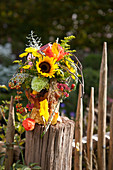 Autumn bouquet of sunflowers and chrysanthemums