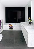 Modern bathroom with marble and high-gloss black wall