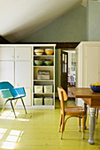 Country-house-style kitchen-dining room with lime-green floor