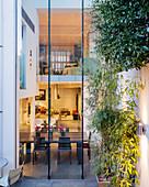 View through two-storey glass façade into luxurious townhouse