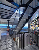 Self-supporting staircase made from perforated metal in modern, architect-designed house