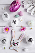 Easter eggs decorated with stickers, bunny biscuit and Easter decorations