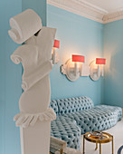 Contemporary stucco ornamentation in open doorway of luxurious interior with sky-blue sofa combination