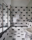 40s-style bathroom tiled in black and white