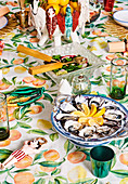 Colorfully decorated Christmas table with a Mediterranean fruit motif tablecloth