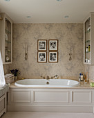 Fitted bathtub with panelled cladding in classic bathroom
