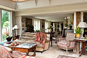 Antique furniture in living room of renovated English country house