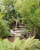 Split-level terrace in lush garden