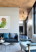 Living room with a picture of a parrot in an open architect's house