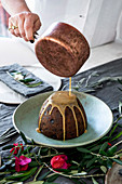 Pour sauce over Christmas pudding