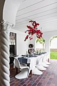 Festive table with bougainvillea decoration