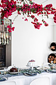 Festive table with bougainvillea decoration