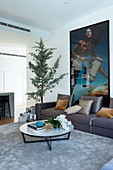 Fashion photography on sofa in living room with Christmas tree